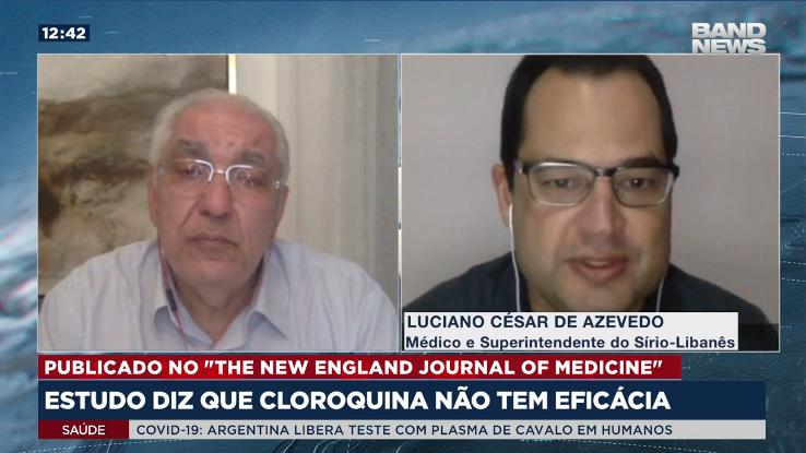 A imagem mostra o Dr. Salim e o Luciano César de Azevedo em uma transmissão ao vivo para a BandNews TV.