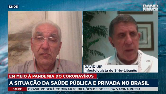 A imagem mostra uma tela dividida em duas partes. Do lado esquerdo está o Dr Salim e do lado direito, o Dr. David Uip.